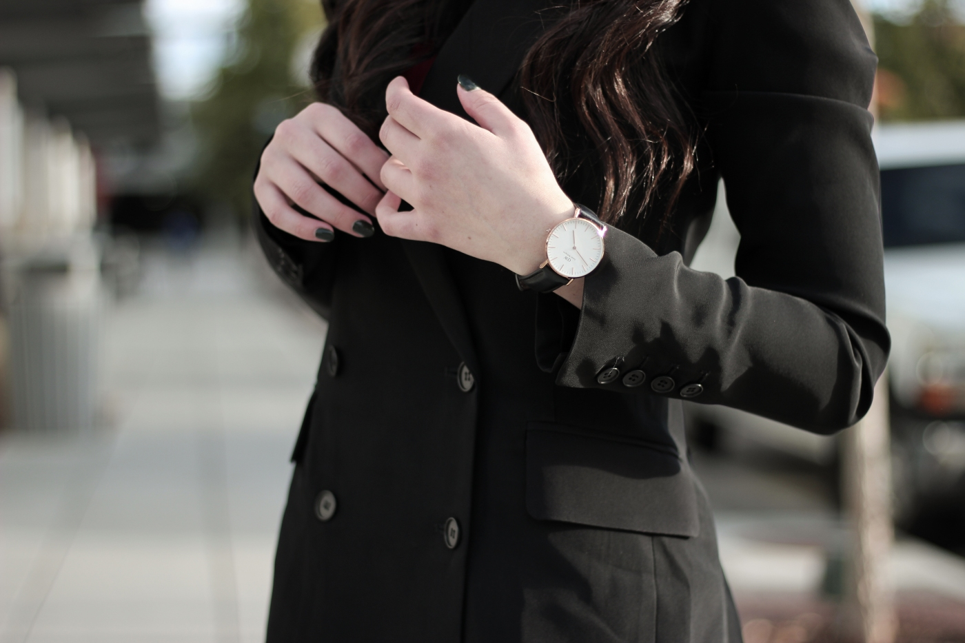 fashion blogger in a city, wearing Stuart Weitzman Lowland over the knee boots, and reformation blazer.