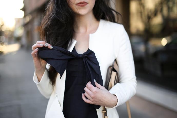 fashion blogger in a city, wearing Hello kestan, and banana republic. Carrying a zara purse and fashion bunker jacket.